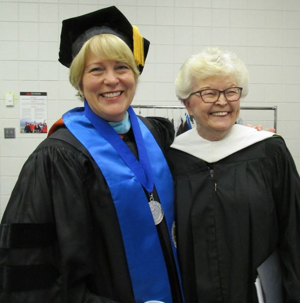 OUTLOOK PHOTO: TERESA CARSON - Two firsts: Debra Derr (left), the first female president of Mt. Hood Community College and commencement speaker Barbara Roberts, the first female governor of Oregon, get ready for the ceremony in the robing room.