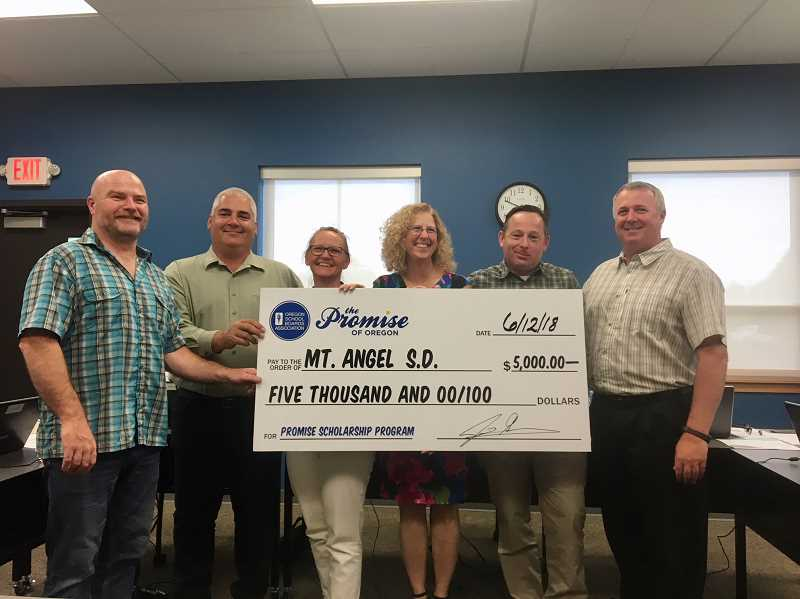 COURTESY PHOTO: MOUNT ANGEL SCHOOL DISTRICT - The Mount Angel School Board was awarded a check from Oregon School Boards Association at the June 12 meeting. OSBA's Renee Sessler (third from right) presented the check to (from left) board members Rod Hill (chair), Ray Frey (vice chair), Shari Riedman, Daniel Crowe and Greg Traeger.
