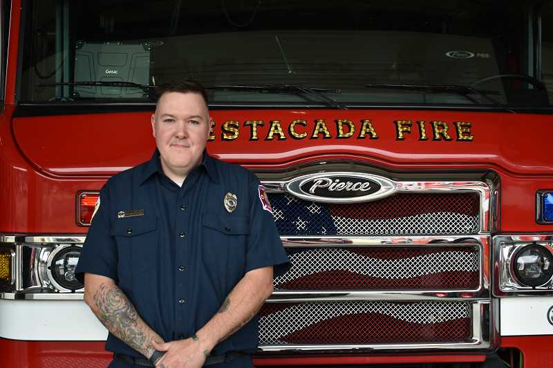 ESTACADA NEWS PHOTO: EMILY LINDSTRAND - Estacada volunteer firefighter Damon Faust has been named the American Legions National Firefighter of the Year and will serve as grand marshal in the upcoming  Fourth of July parade in town.