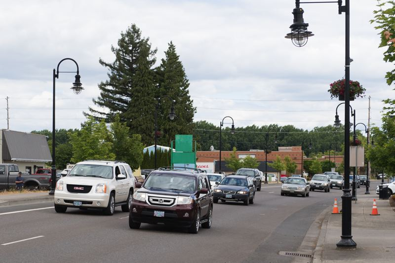 STAFF PHOTO: CHRISTOPHER OERTELL - North Adair Street, pictured, and Baseline Street carry thousands of vehicles' worth of highway traffic through Cornelius on a daily basis. That traffic isn't about to go away, but city officials would like to see their downtown area as something more than a pass-through.