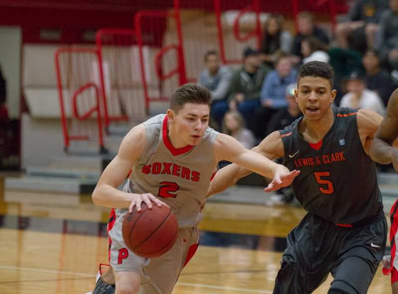 COURTESY PHOTO: TREVIS FONG - Pacific's Brevin Brown dribbles around a defender during a Boxer game last winter. Pacific University will host basketball and shooting camps this summer and fall, hosted by new head coach Justin Lunt, who came to Pacific from the University of Puget Sound.