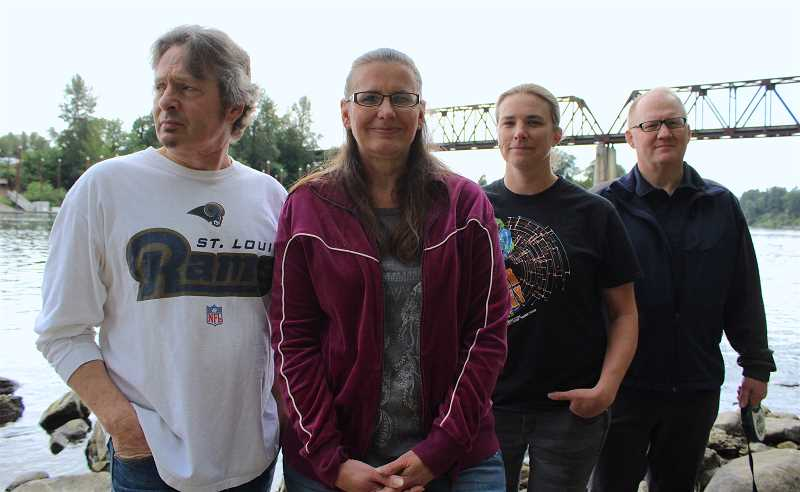 SPOKESMAN PHOTO: SAM STITES - Rob and Michele Dempsey, Amanda Hoffman and Eric Winters are the four Boones Ferry Road residents leading the opposition to the proposed bridge connecting the Boones Ferry Park area across the Willamette River.