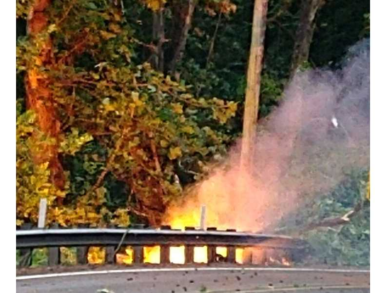 COURTESY PHOTO - Two small brush fires caused by Sundays storm were put out quickly but caused some road closures.