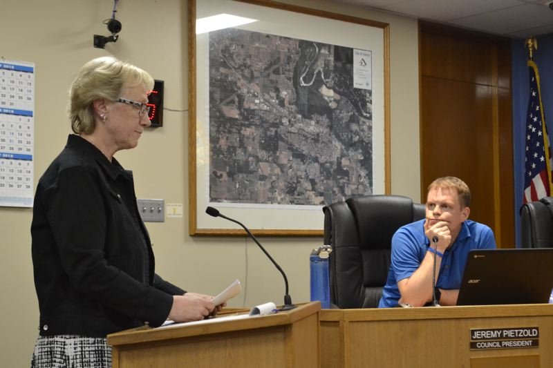 POST PHOTO: BRITTANY ALLEN - Clackamas County Bank President Cathy Stuchlik spoke on behalf of the bank, voicing concerns over the proposed plan's 'negative impact' on the business' parking situation.