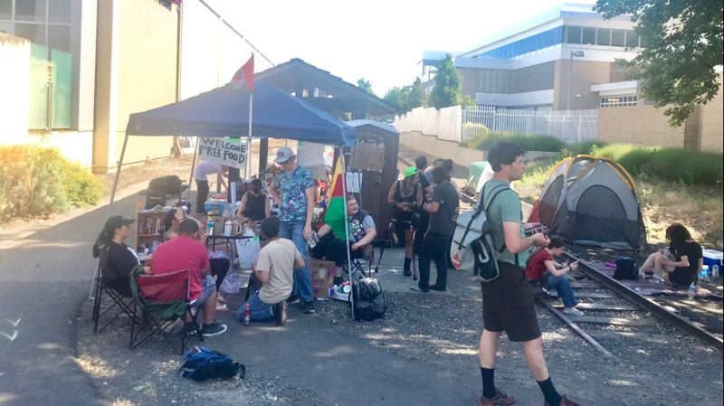 PORTLAND TRIBUNE: HAILEY STEWART - Protesters set up a sation for food and water.