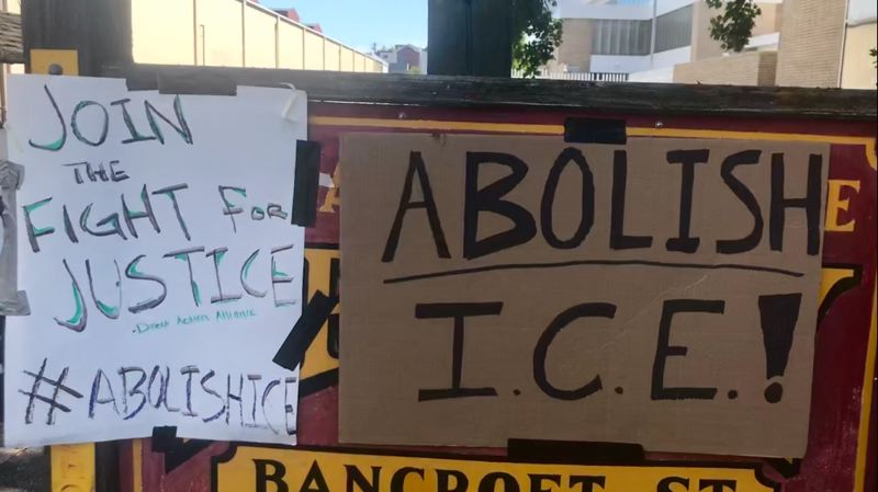 PORTLAND TRIBUNE: HAILEY STEWART - Signs line the street and cover existing street signs at ICE headquarters.