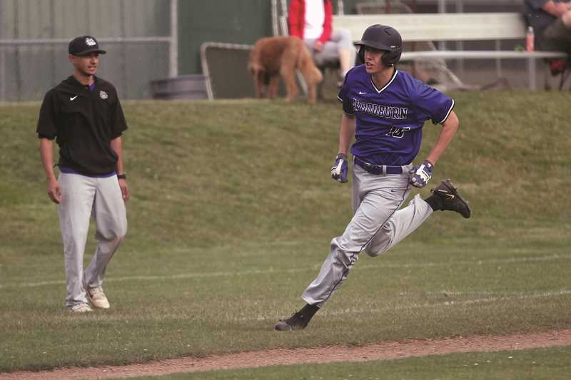PHIL HAWKINS - Sophomore Reese Miller rounds third base to score in a summer league game against South Salem last week, where the Bulldogs continue to practice in preparation of return to varsity baseball next season.