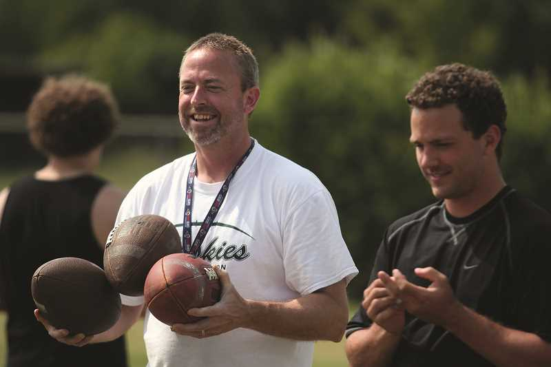 PHIL HAWKINS - North Marion football head coach Keith Bennett (left) led a defense that held Oregon West opponents to just 11.7 points over the past two seasons. Assistant coach Ryan Sederstrom (right) will take over defensive coordinator duties for the Huskies this year.