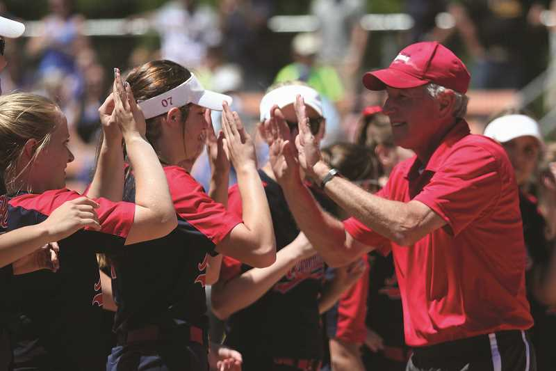 PHIL HAWKINS - Kennedy Head Coach Walt Simmons exchanges high fives with Ellie Cantu and Emily Cuff before the 2018 State Championship game on June 1. Simmons was named 2018 2A/1A Coach of the Year, while Cantu earned Second Team All-State recognition.
