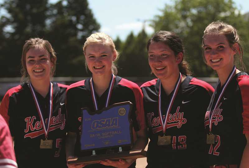 PHIL HAWKINS - Kennedy seniors (from left) Hannah Arritola, Molly Jaeger, Abby Frey and Tressa Riedman were named to the 2018 2A/1A Softball All-State First Team. Riedman was also named Pitcher of the Year and Player of the Year, while Head Coach Walt Simmons was honored as Coach of the Year. Freshman teammate Ellie Cantu rounded out the All-State awards by picking up Second Team consideration.