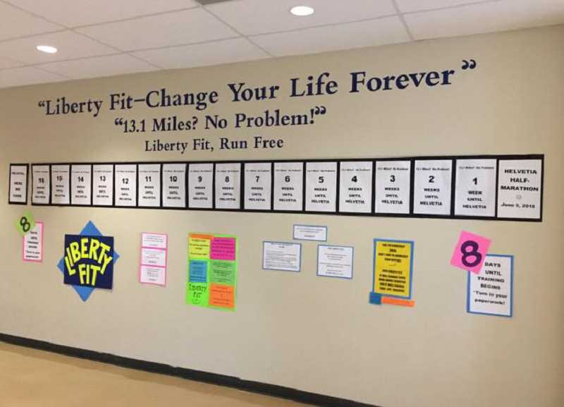 COURTESY PHOTO - Liberty Fit's wall of inspiration in the halls at Liberty High School motivates kids and chronicles their journey to the Helvetia half-marathon.