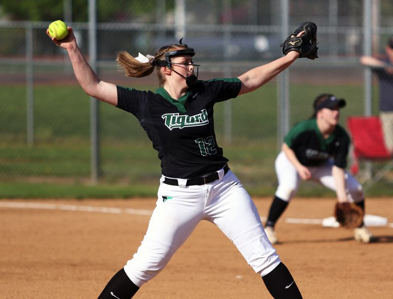 TIMES PHOTO: DAN BROOD - Tigards Ashley Davis, here throwing a pitch in a win over Sherwood, was named the Class 6A softball Pitcher of the Year.