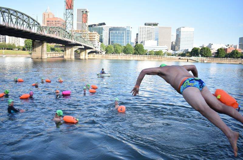 TRIBUNE PHOTO: HAILEY STEWART - Willie Levenson, Human Access Project ringleader, jumps into the Willamette River early Monday morning.