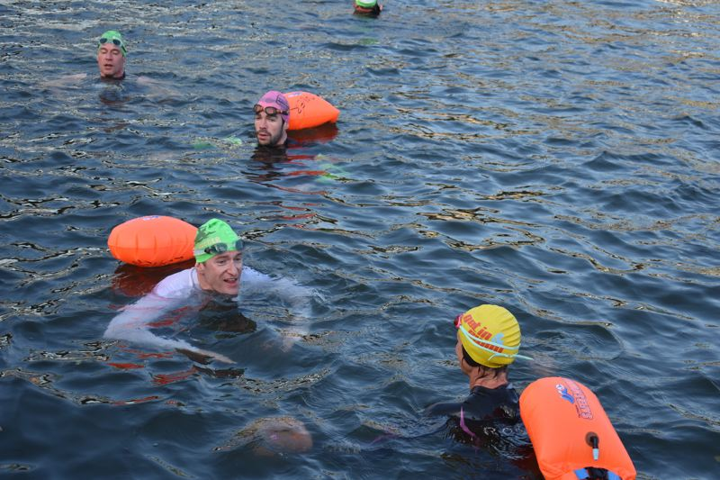 TRIBUNE PHOTO: HAILEY STEWART - Mayor Ted Wheeler joined the River Huggers to start their 2018 summer swim season on the Willamette River on Monday, June 18.