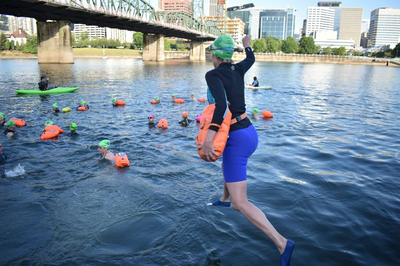 TRIBUNE PHOTO: HAILEY STEWART - A River Hugger takes the plunge into the Willamette on Monday, June 18.
