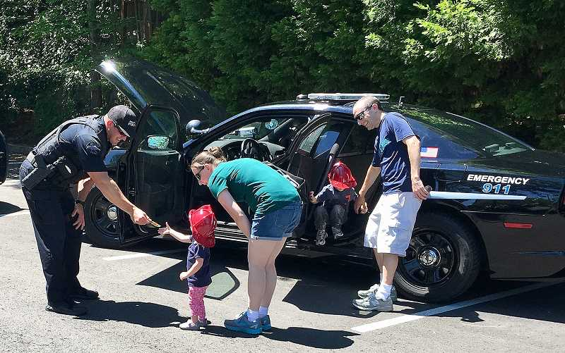 SUBMITTED PHOTO: JEFF HALVERSON - Kids had a chance to check out police, fire and public works vehicles during the West Linn Touch a Truck event June 17.