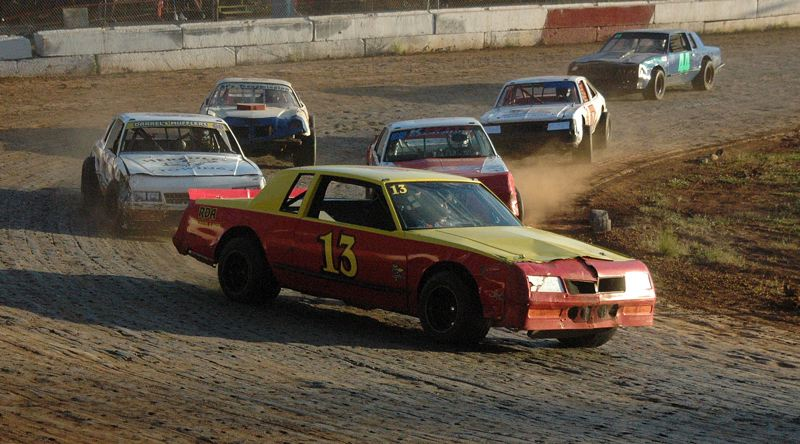 SPOTLIGHT PHOTO: MIKE WEBER - Terry King of Warren leads Saturday's Street Stock main event during the June 16 Sam Brittain Memorial Race.