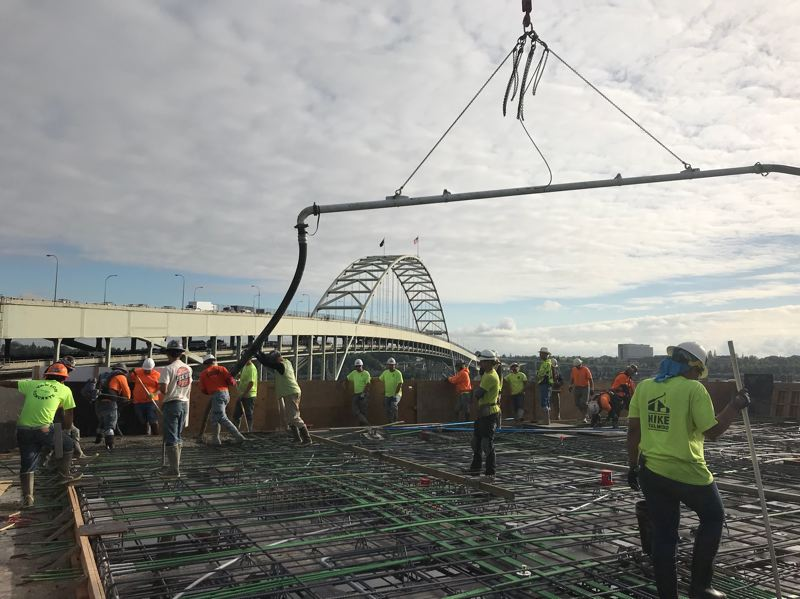 PHOTO: DESMOND EVANS AT BREMIK - The view northeast to the Fremont Bridge as concrete is poured for one of the higher floors.