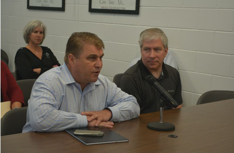 SPOTLIGHT PHOTO: COURTNEY VAUGHN - Mike Jeffries (left) of Waste Management and Joe Wonderlick (right) of Hudson Garbage Service answer questions from Columbia County commissioners during a meeting Wednesday, June 20.