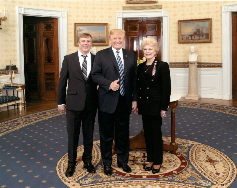 WHITE HOUSE PHOTO - Marilynn Lieurance (pictured to the right) and her nephew, Scott Turley, meet with 45th President Donald Trump at the White House in June 2018.