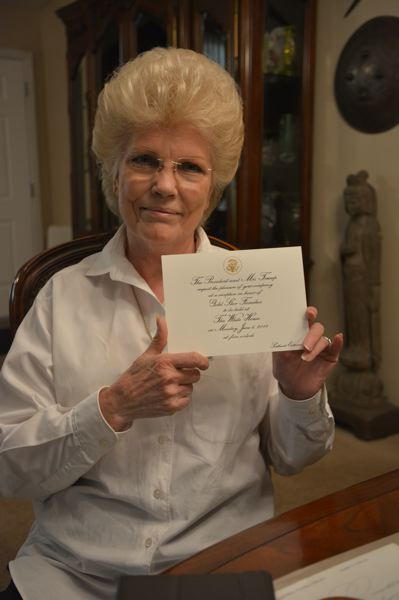 SPOTLIGHT PHOTO: COURTNEY VAUGHN - Marilynn Lieurance holds the official invite she received in the mail from the White House. Lieurance traveled to Washington, D.C., for a special ceremony honoring fallen soldiers.