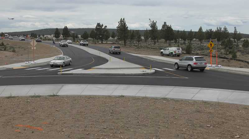PHOTO COURTESY OF ODOT - The Tom McCall Road/Highway 126 roundabout opened to east-west traffic Friday, but work remains before the project is complete.