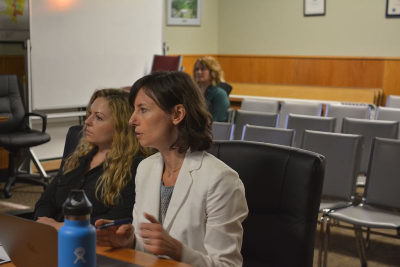 SPOTLIGHT PHOTO: COURTNEY VAUGHN - Lorelei Juntunen (pictured right) of ECONorthwest and Alexandra Rains, a Scappoose city staff member, present options for an urban renewal district in Scappoose during a City Council meeting Monday, June 18.