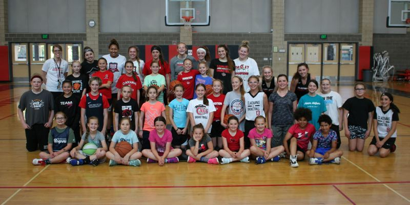 PAMPLIN MEDIA: JIM BESEDA - Clackamas coach Korey Landolt (back row, left) and several of the Cavaliers' varsity players share their knowledge and love for girls' basketball with 31 players in grades 3-8 during last week's youth camp at Clackamas High School.