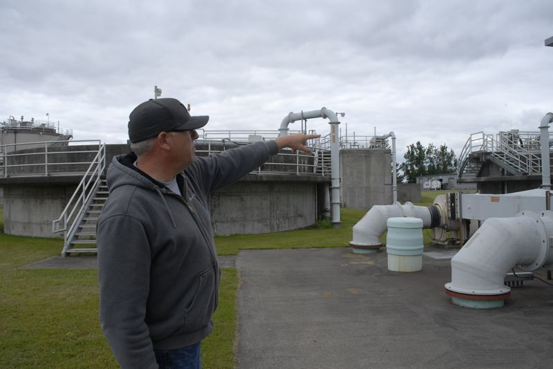 OUTLOOK PHOTO: MATT DEBOW - Wastewater Treatment Plant Chief Operator Shawn Anderson explains the operation of Troutdales wastewater treatment plant on Friday, June 15.