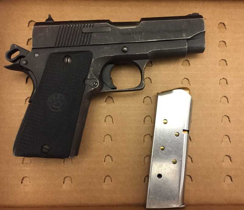 COURTESY OF PORTLAND POLICE BUREAU - Here's one of the two guns confiscated during the arrests made in the Montavilla neighborhood of Southeast Portland on June 21.