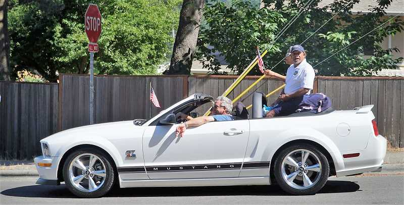 COURTESY: JAIMIE FENDER - Mayor Ken Gibson sits on the back of a convertible during last year's First Annual Walk & Roll Parade.