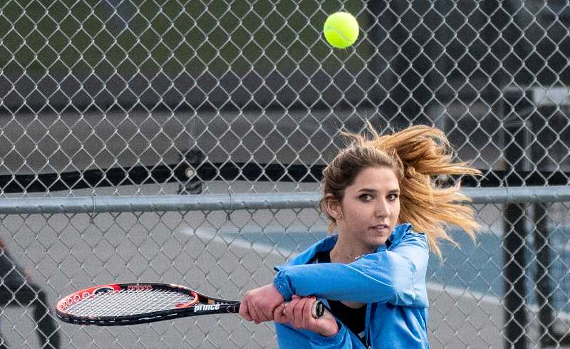 LON AUSTIN/CENTRAL OREGONIAN - Kadence Kee plays a backhand winner. Kee and doubles partner Sarah Connolly were one of the top doubles teams in the league and are two of a group of Cowgirl players who graduated this year.