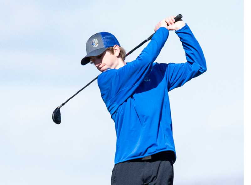 LON AUSTIN/CENTRAL OREGONIAN - Brodie Kuizenga plays a tee shot at Juniper Golf Course this spring. Kuizenga shot his best round of the year at the district tournament and is expected to be one of the team's leaders next year.