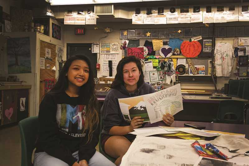 PATRICK EVANS - North Marion High School students Isabella Mon,left, and Gabriella Luna, right, worked with a group of fellow art students to produce concepts for a flag for the City of Hubbard. Mon and Luna presented the designs to the Hubbard City Council June 12.