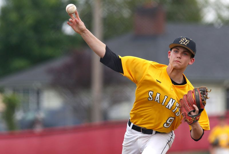 SPOTLIGHT PHOTO: JONATHAN HOUSE - St. Helens Saints pitcher Kaleb Edwards delivers during his team's  8-4 win at Madison on Monday.
