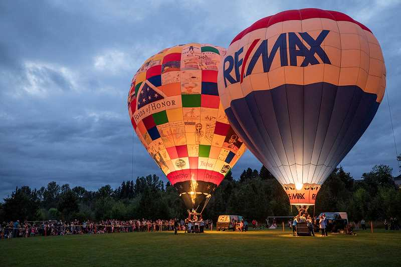 THE TIMES: JONATHAN HOUSE - The Tigard Festival of Balloons Night Glow event featured both the Folds of Honor and RE/MAX balloons.