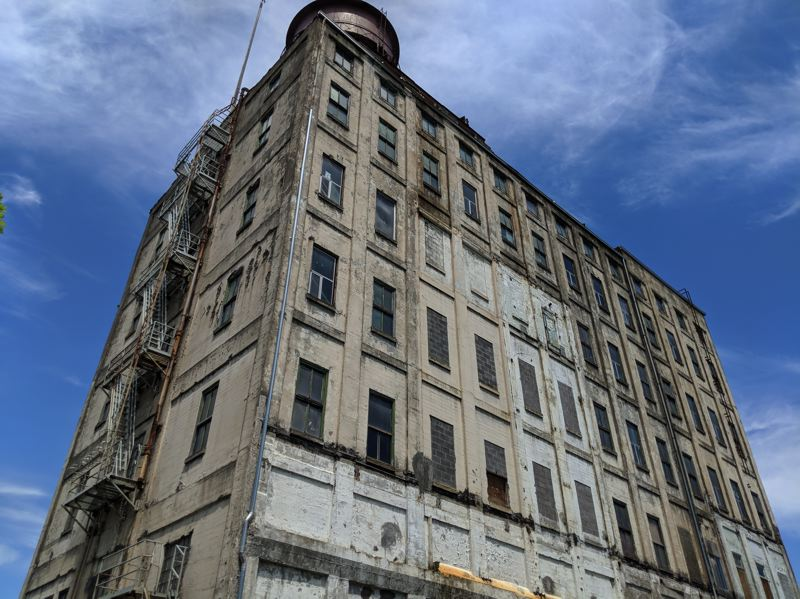 PAMPLIN MEDIA GROUP: JOSEPH GALLIVAN  - The flour mill and water tower at the Centennial Mills site. The property will likely be bought this summer from the city by the Lynd Company of Austin Texas, known for owning apartments and for developing high-end condos.