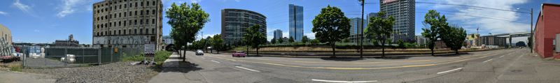 PAMPLIN MEDIA GROUP: JOSEPH GALLIVAN  - Pearl District condos seen from the Centennial Mills site. The developer and architect are well aware that, depending on the massing of the apartments and condos they build, some of these residents might lose their river views. Locals at the meeting enquired about a pedestrian bridge over the train tracks, and ways to cut car congestion when freight trains pass through.
