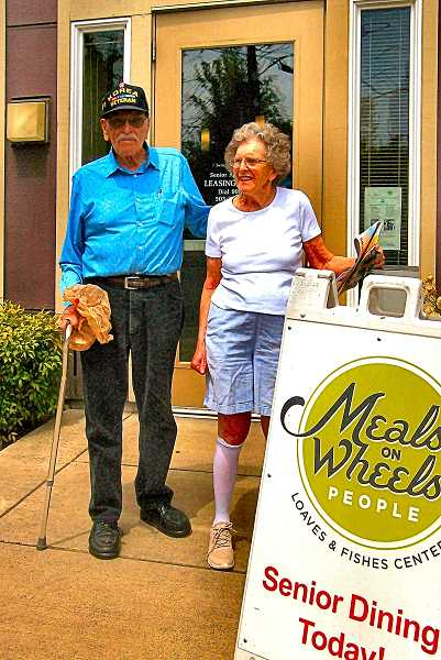 RITA A. LEONARD - Korean War Veteran Bruce Wickward told THE BEE he has enjoyed the meals and company he found while dining in the now-closed Meals On Wheels Center in Brooklyn; standing with him is a resident of Sacred Heart villa, Priscilla Manning.