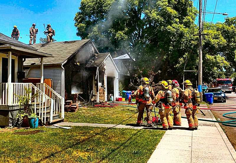 COURTESY OF PF&R - A PF&R Rapid Intervention Team stood by to rescue firefighters, if needed, as they battled a house fire on S.E. Rhone Street in the Foster-Powell neighborhood.