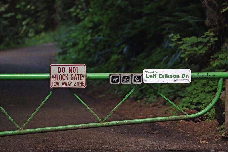 TRIBUNE PHOTO:S JESSIE DARLAND - Signs at Leif Erikson Drive designate the path as friendly to horses, hikers, and bikers, as well as give information about the Olmsted's legacy.