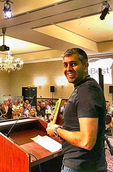 Farhad Ghararzade, founder of Green Drop Garage, receives the award in a June 11 ceremony.