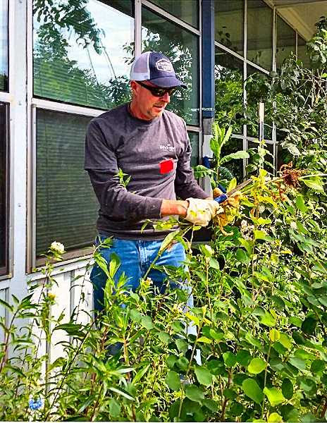 Bill Granger of Windermere's Westmoreland office helped tidy up at Gilbert Park SUN Community School as part of Windermeres annual Community Service Day.
