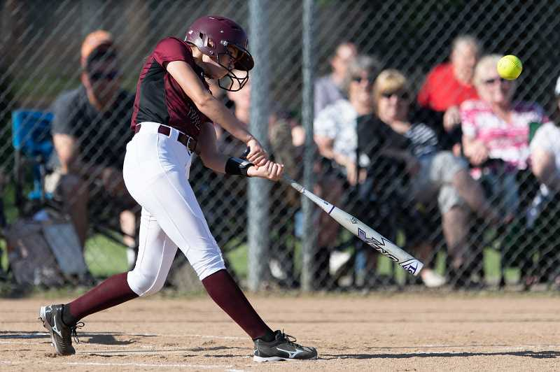 STAFF PHOTO: CHRISTOPHER OERTELL - Glencoe junior Jensen Becker takes a cut during a Tide game earlier this season. Becker was a 6A third team all-state softball selection.