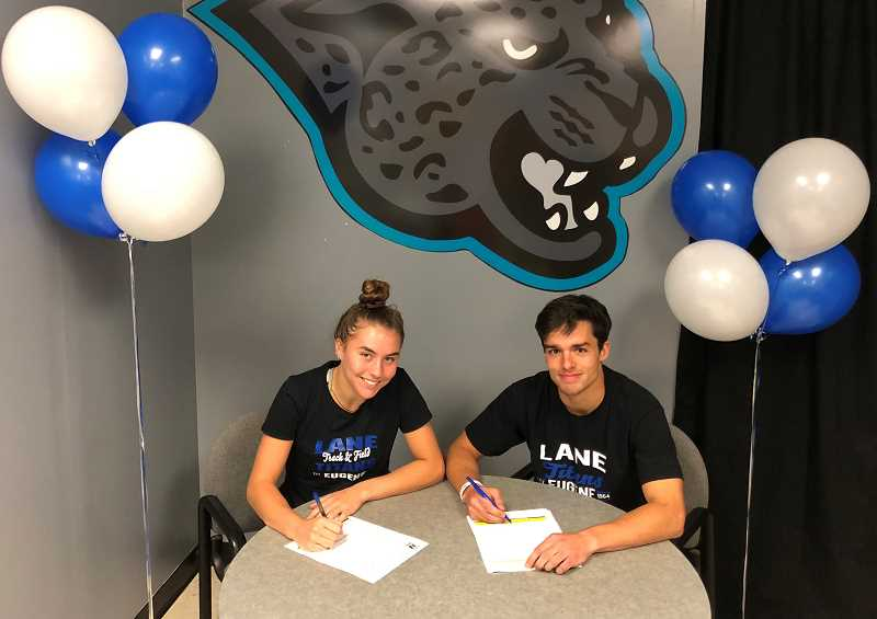 COURTESY PHOTO - Century's Nina Mastrantonio and Nathan Poff sign their letters of intent to compete in track and field at Lane Community College in Eugene.