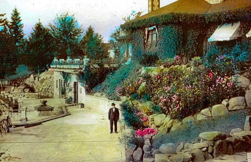 COURTESY DON NELSON, AND SMILE HISTORY COMMITTEE - This 1912 photo of the Portland Crematorium shows off the professionally-landscaped garden on the west side of the building, with the ivy-covered back side of the chapel off to the right. The man decked out in the suit and hat might be one of the caretakers of the then-new funeral home.