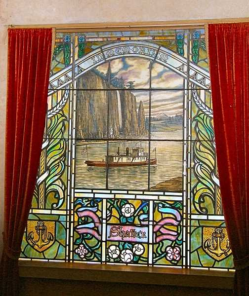 DANA BECK - This stained glass window, in the Shaver niche at Wilhems Portland Memorial Mausoleum, depicts Captain Delmer Shavers boat, the James W, meandering down the Columbia River, with one of the waterfalls in the Columbia Gorge shown behind it.