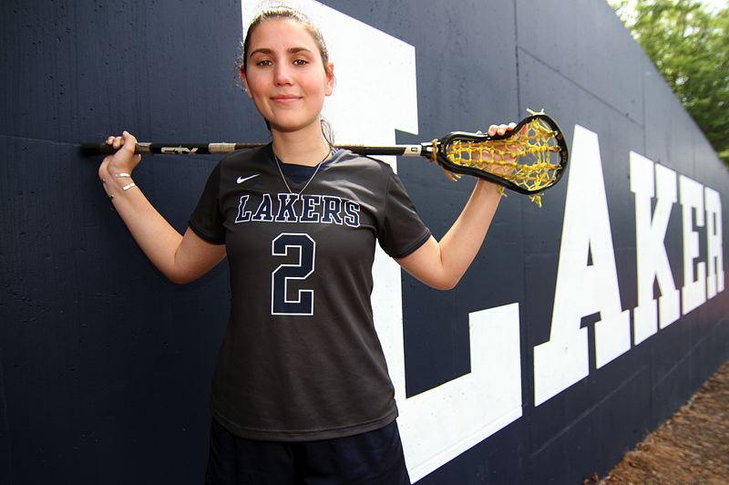 REVIEW PHOTO: MILES VANCE - Carlie Leach was never more at home than when she had her lacrosse stick in her hands, helping lead the Lakers to a third straight OGLA state championship this spring.