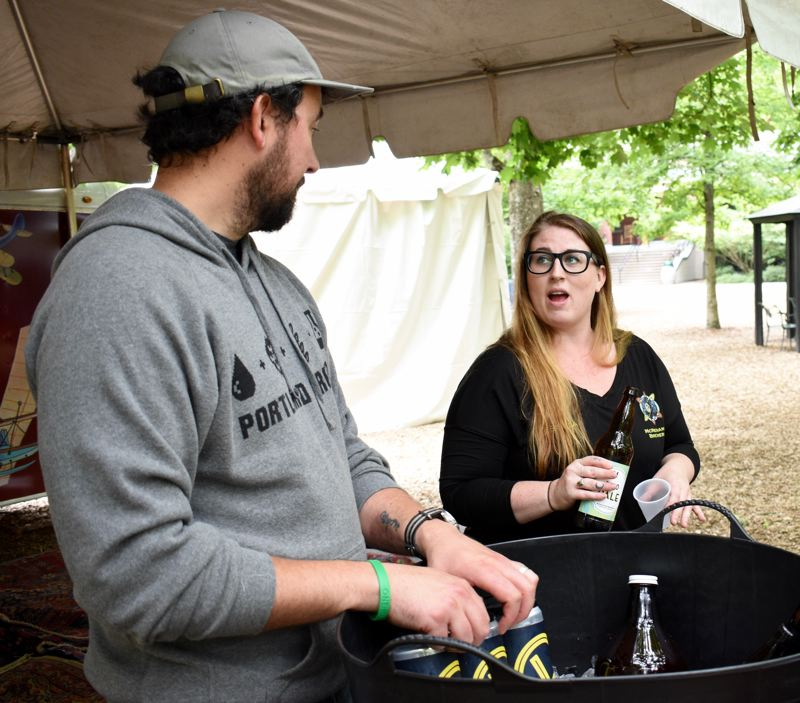 OUTLOOK PHOTO: MATT DEBOW - Jason Barbee, co-owner of Level Brewing, talks with Jessica Standley, McMenamins brewery administrator, on Thursday, June 21, while pouring beer during a media preview event for the upcoming inaugural McMenamins Edgefield Brewfest on Saturday, June 30.