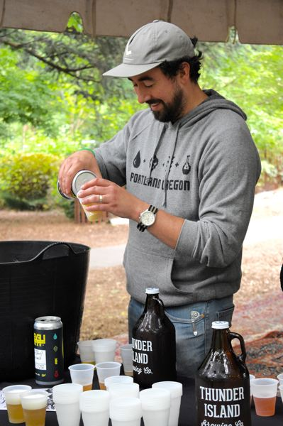 OUTLOOK PHOTO: MATT DEBOW - Jason Barbee, Level Brewing co-owner, pours a beer sample on Thursday, June 21, during a media preview event for the upcoming inaugural McMenamins Edgefield Brewfest on Saturday, June 30.